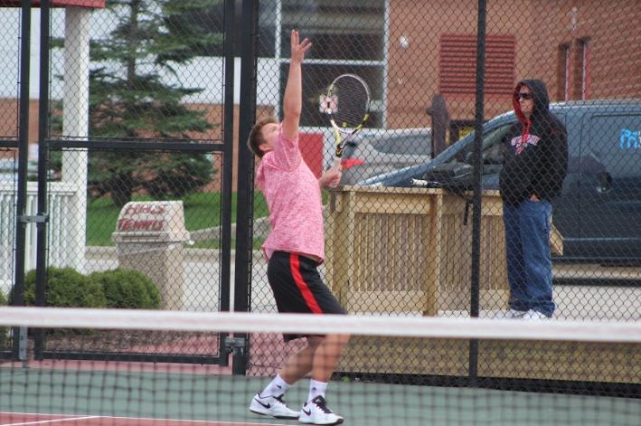 Tucker Gabriel, senior, serves the ball.