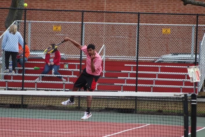 Sydan Parker, senior, serves the ball.