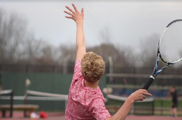 Connor Mason, junior, serves the ball.