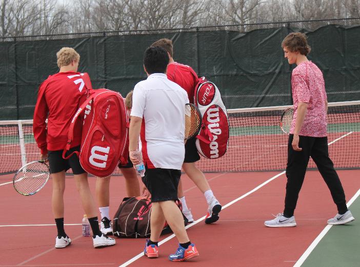 Varsity tennis boys get ready to play against Grafton High School