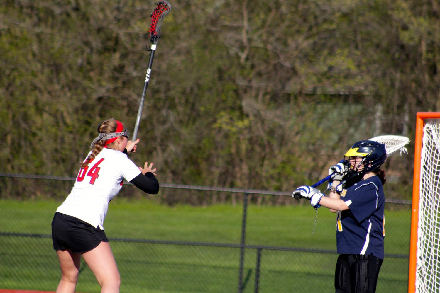 Amy Erpenbeck, freshman, blocks the goalie.