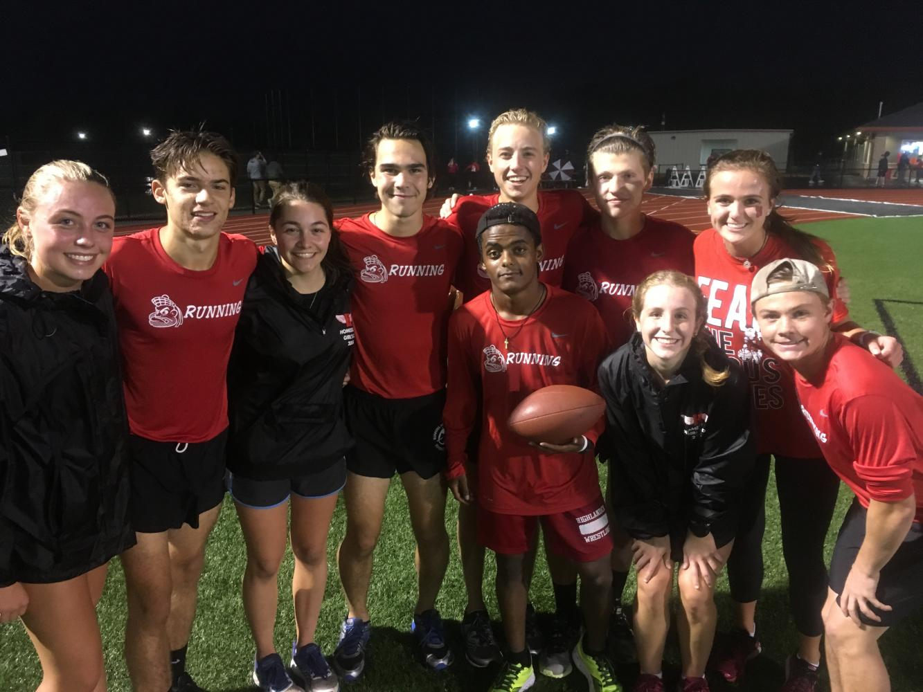 The seniors of the cross country team ran the game ball for the homecoming football game from Hartford to Mequon.