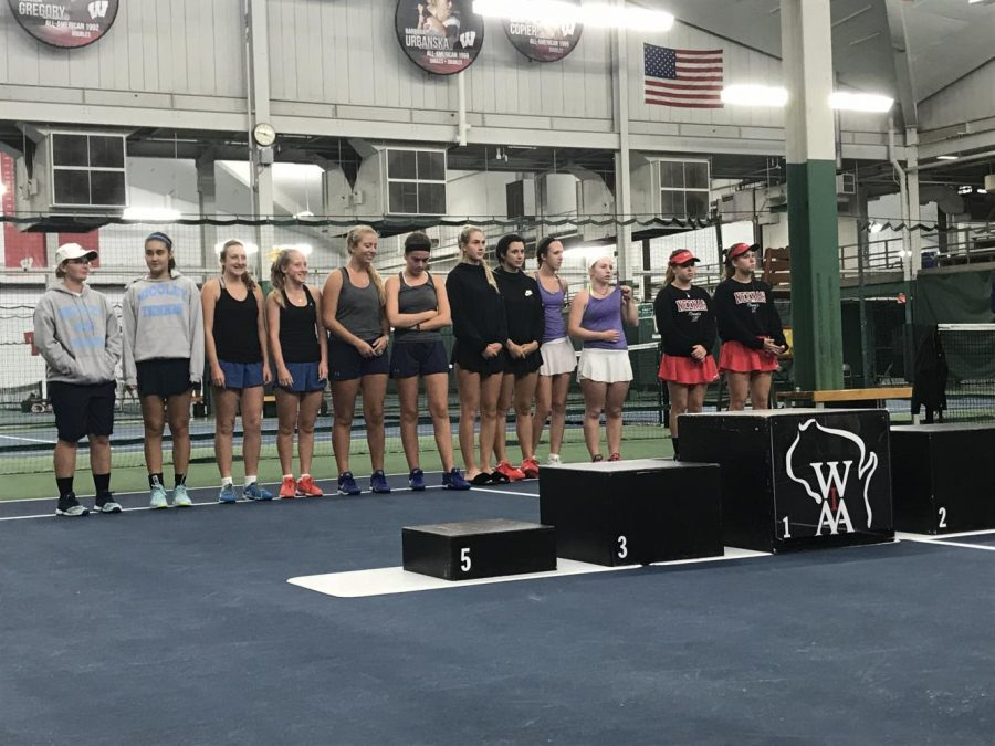The top six doubles teams in the state line up to podium.