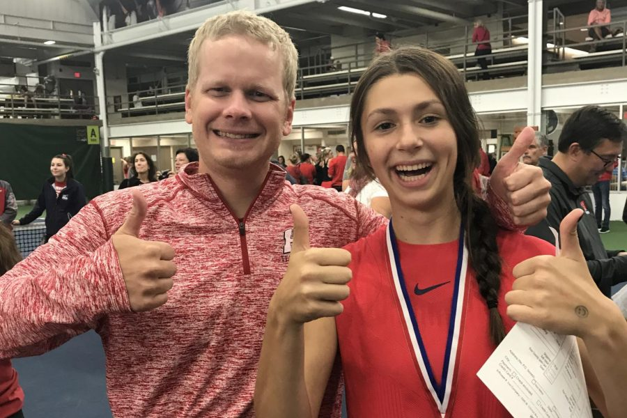 Sasha Shapsis, sophomore, and Luther Tollefson, JV tennis coach, give the camera thumbs at Nielsen on Saturday after winning the state title.