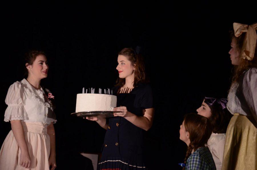 Bella+Gabor%2C+junior%2C+and+Emily+Limbach%2C+senior%2C+perform+a+scene+in+the+play+in+the+auditorium.+