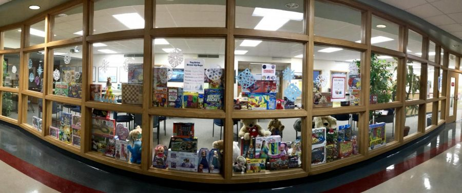 Toys donated for the toy drive are displayed in the windows of the counseling office.