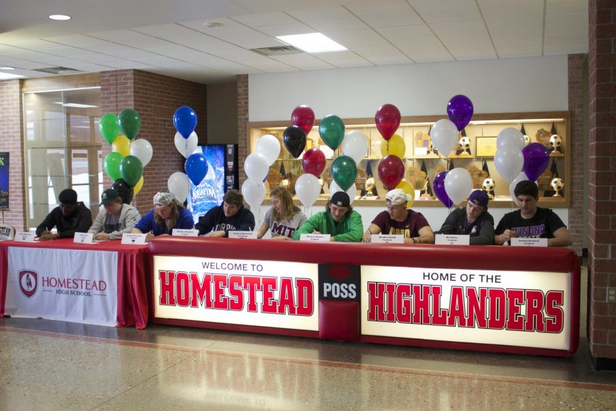 Seniors sign their National Letters of Intent.