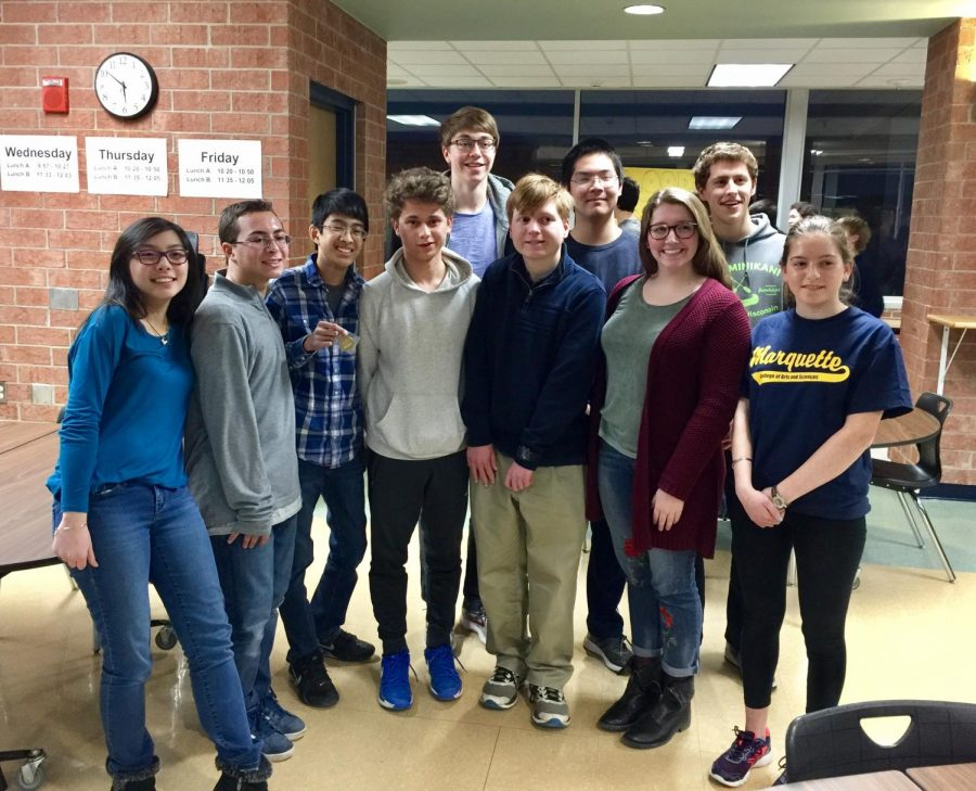 The varsity math team smiles for a photo. (Front row left to right): Giana Lim, Michael Pokorny, Julian Camacho, Jake Yasonik, Stephen Marcon, Katie McCarthy, Shir Bloch. (Back row left to right): Christopher Aceto, Andrew Wang, Max Kroft