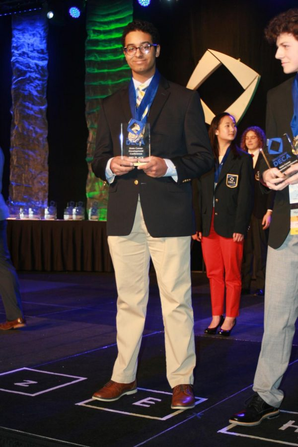 Blackwell holds his trophy and medal for taking fifth place for his project in Business Operations Research and third for his test and role plays in Entrepreneurship Series Event Role Play.