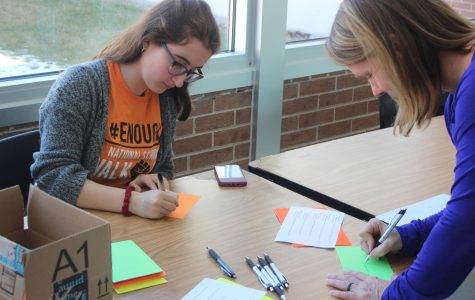 Students honor lives lost in Columbine shooting by writing postcards to state legislators