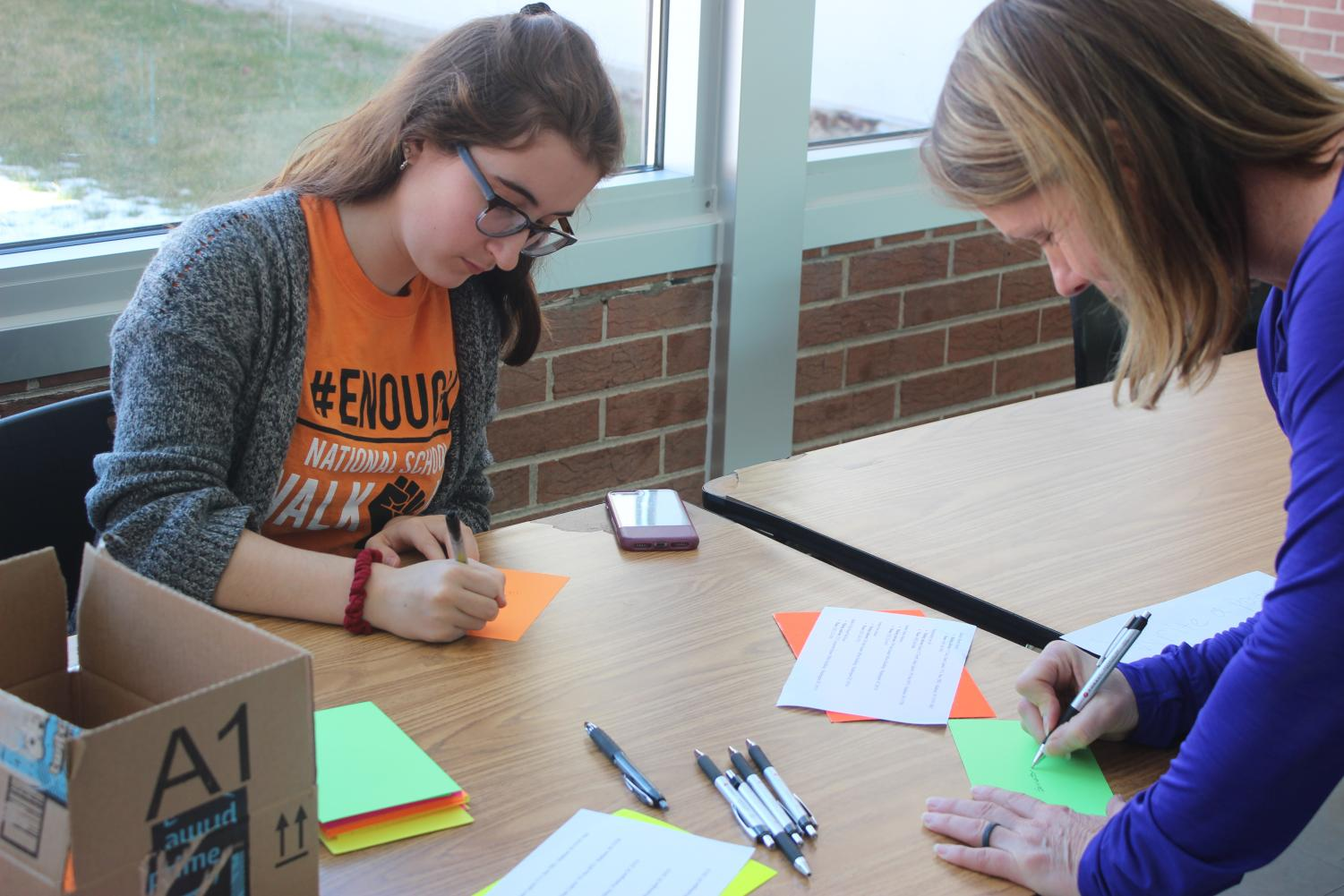 Isabel Klemmer, sophomore, and Mrs. Susie Godfrey, Physical Education teacher, write letters to state legislators.