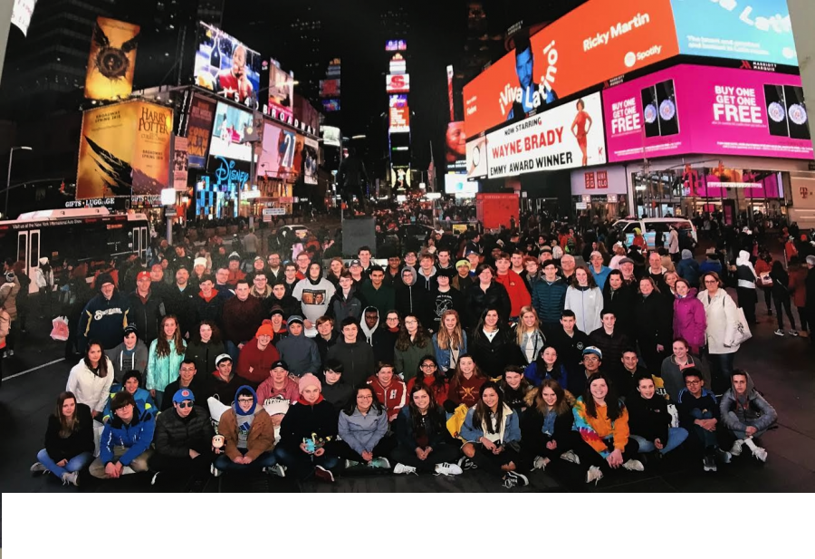 The group smiles in Times Square during their free time in New York City.