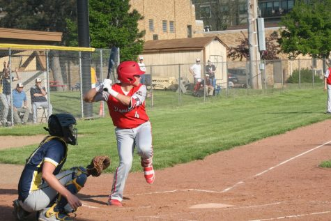 Baseball team wins first game of season
