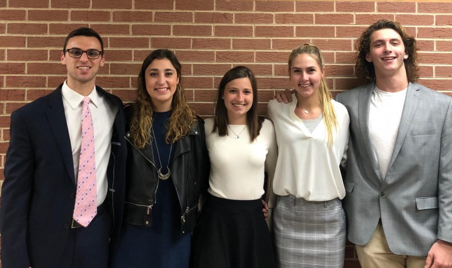 (left to right): Bailey Kramer, Caitlin Geurts, Kayla Zimdars, Frankie LaLonde and Mike Bruner smile for a photo.