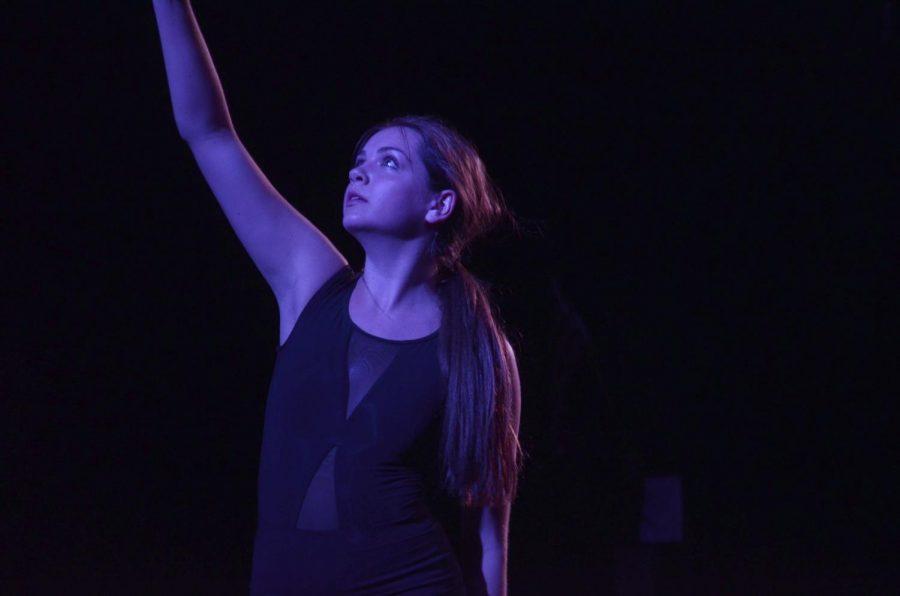 Meg+Niedfeldt%2C+senior%2C+performs+a+dance+piece+to+the+song+Planetarium.+