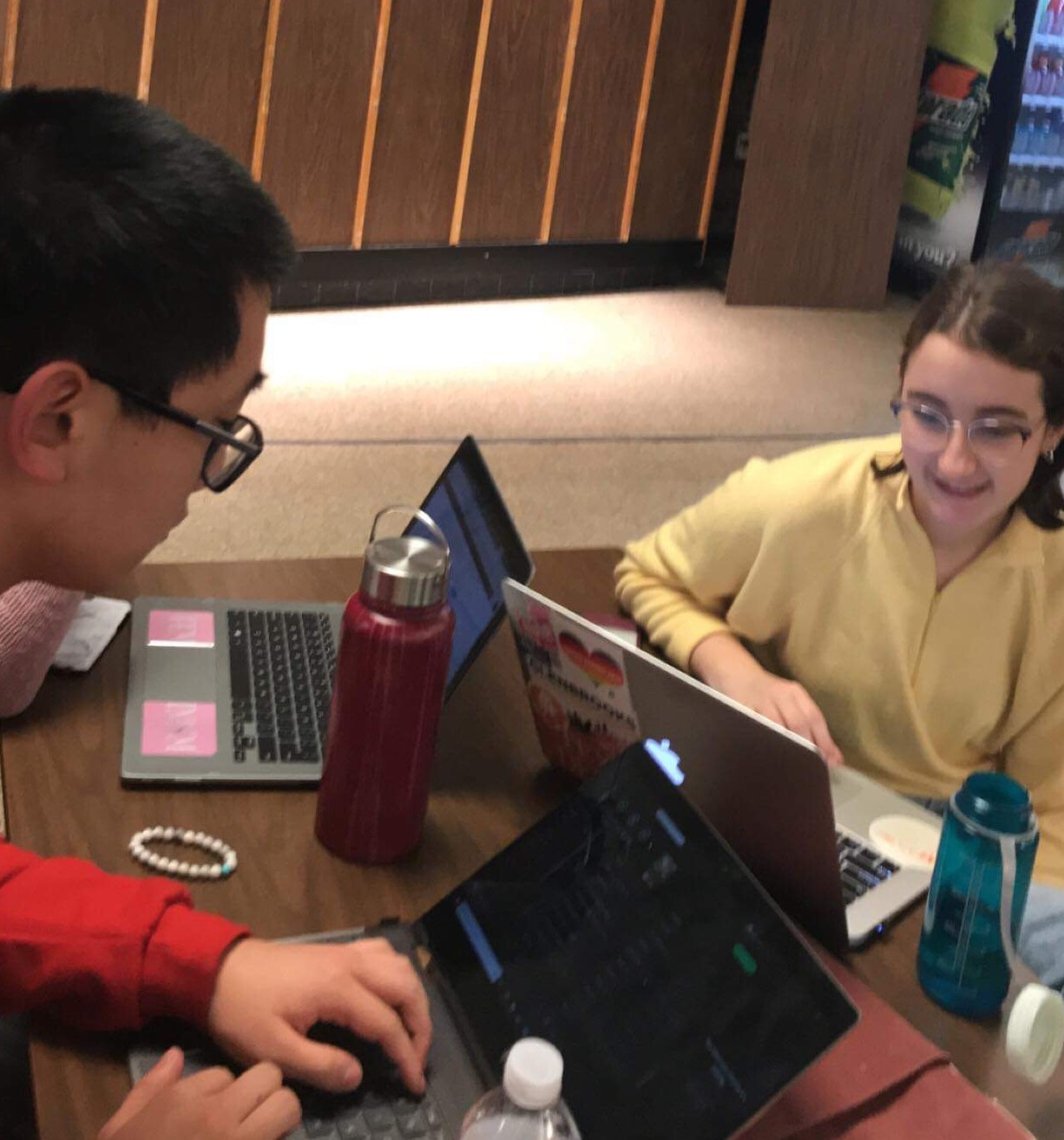 Debate team members, Tyler Gao, senior, and Isabel Klemmer, junior, get ready for their debates