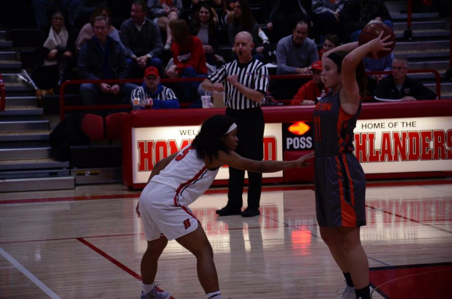 Daja+Young%2C+sophomore%2C+blocks+the+opponent+during+the+first+half.+