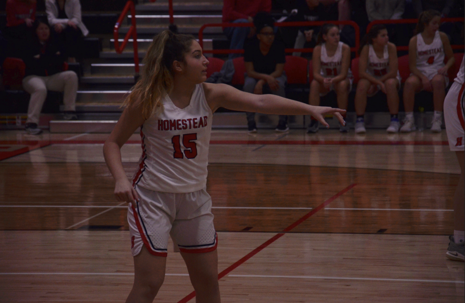 McKenna Marotta, sophomore, directs her teammates during the game.