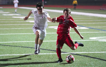 Sam Walton, freshman, takes his shot at goal playing for Homestead's varsity soccer team.