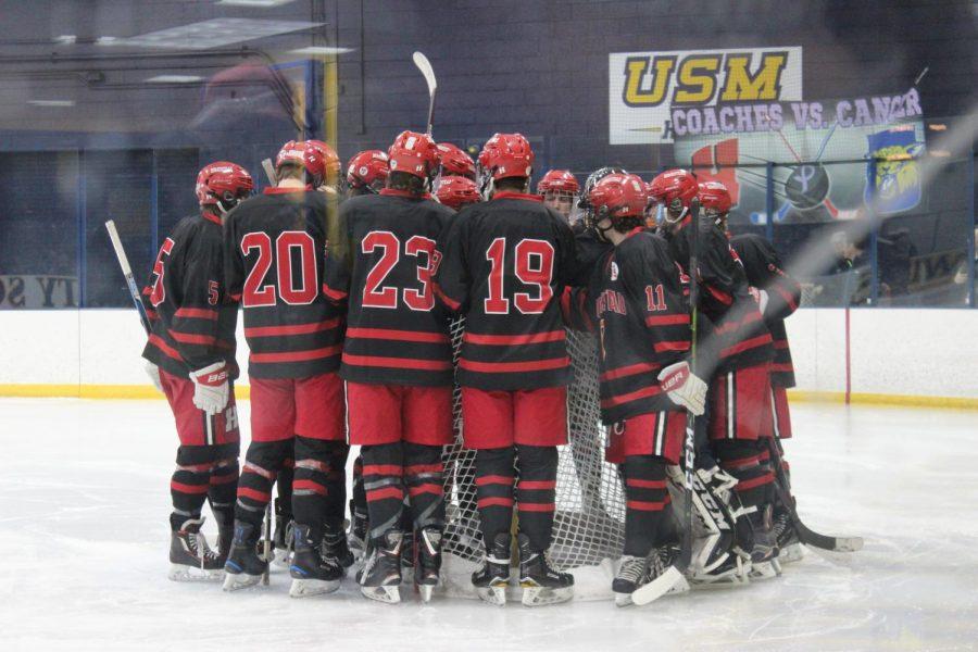 Game+time.+Boys+varsity+hockey+team+convenes+before+the+game+starts.
