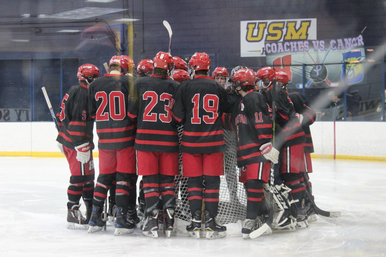 Game time. Boys varsity hockey team convenes before the game starts.