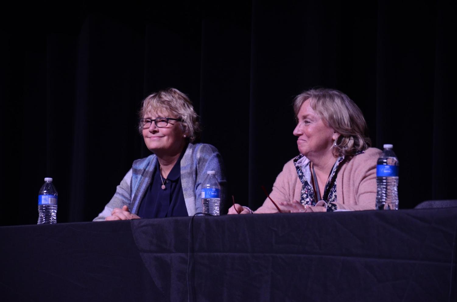 Dr. Charlene Gaebler (left) and Sue Martin (right) observe another speaker.