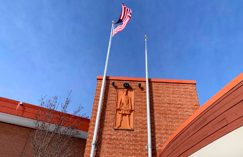 The United States flag waves high over Homestead High School on the Highlander walkway, greeting students and staff walking into the school.