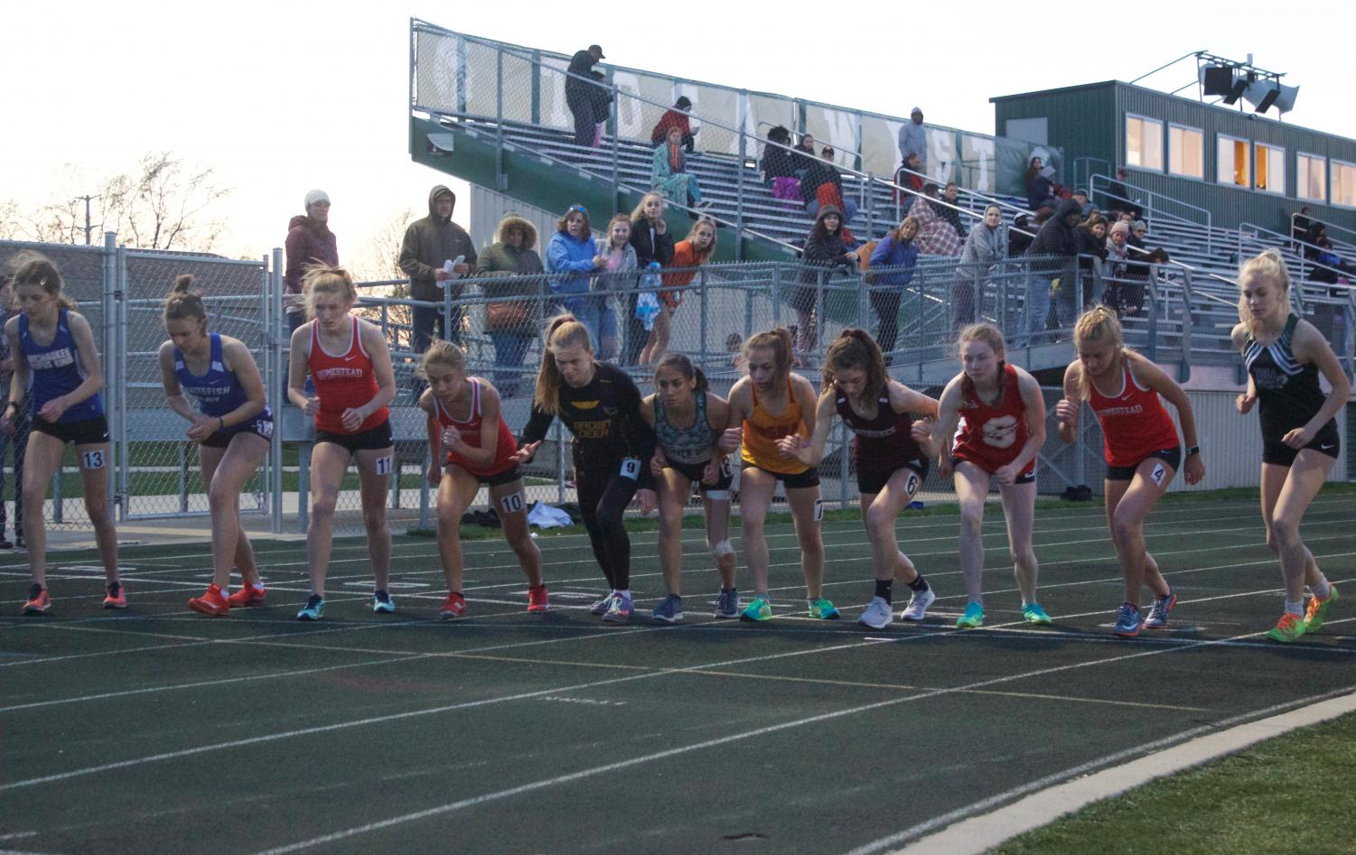 Runners line up for the girls 3200 meter run.