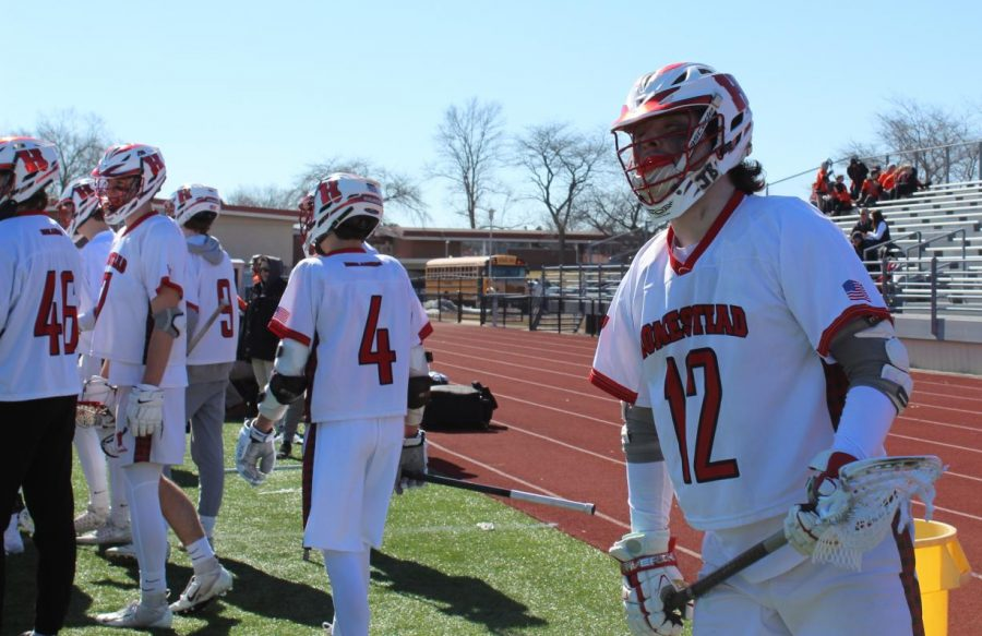 Andrew+Brooks%2C+senior%2C+prepares+to+go+out+on+the+field+during+the+first+lacrosse+game+of+the+season.