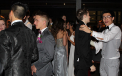 Andrew Shih and John Stoker, Class of '20, dance together at prom in 2019. This was the last prom event held before the pandemic.