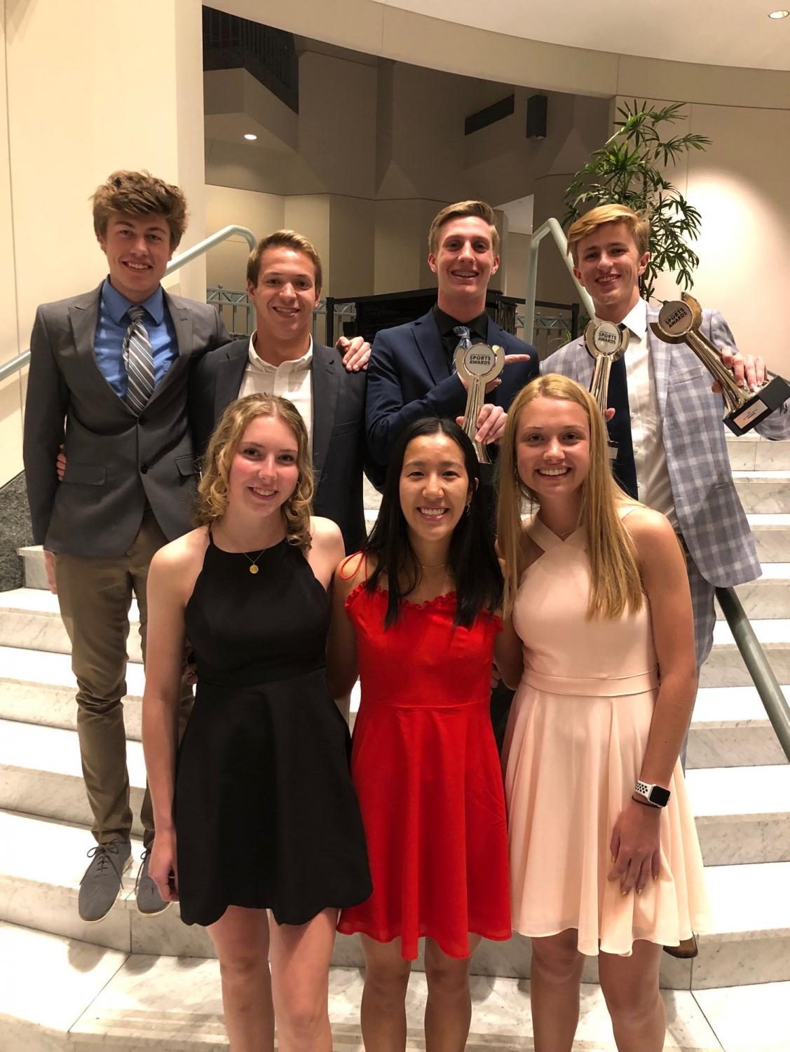 Pierce Stastney, Zach Teplin, Jared Schneider, Drew Bosley, and Paige Weir, seniors, Natalie Yang, junior, and Leane Willemse, sophomore, pose after the awards ceremony. Not pictured Taylor Raskin, junior.