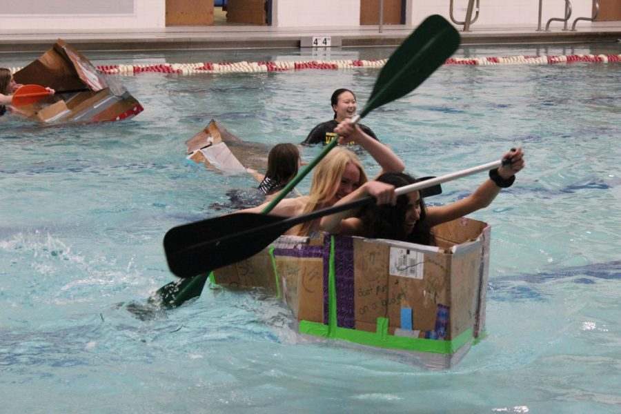 Anna+Lalande%2C+and+Jasmine+Machhi%2C+seniors%2C+row+their+boat.+