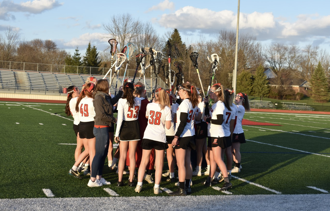 Homestead's Girls Lacrosse team prepares to reenter the field in a home game against Wauwatosa.