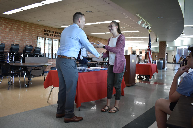 Maddie Ludwig, freshman, receives the Merit Award.