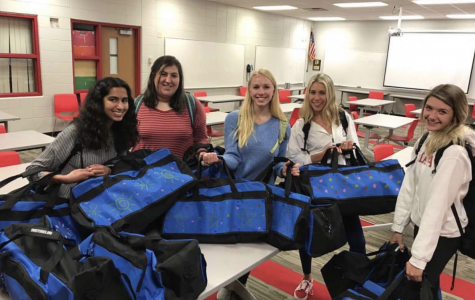 SHIFT donates duffel bags to Children's Hospital for foster teens