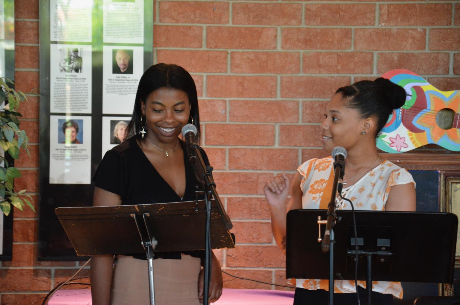 India Wilkerson and Brooke Bell share a laugh while performing a spoken word