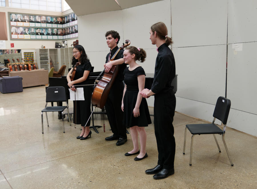 Hope Kim, Zach Tanz, Charlotte Trumble, and Noah Zach, seniors, receive a round of applause at the end of their recital.
