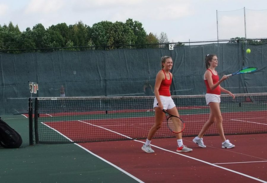 Bridget+Brown+%28left%29%2C+senior%2C+and+Ellie+Sprinkmann+%28right%29%2C+sophomore%2C+walk+off+of+the+court+after+their+successful+match.