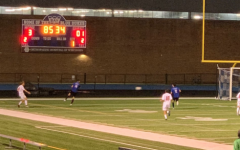 Boys soccer battles Bay but surrenders undefeated title