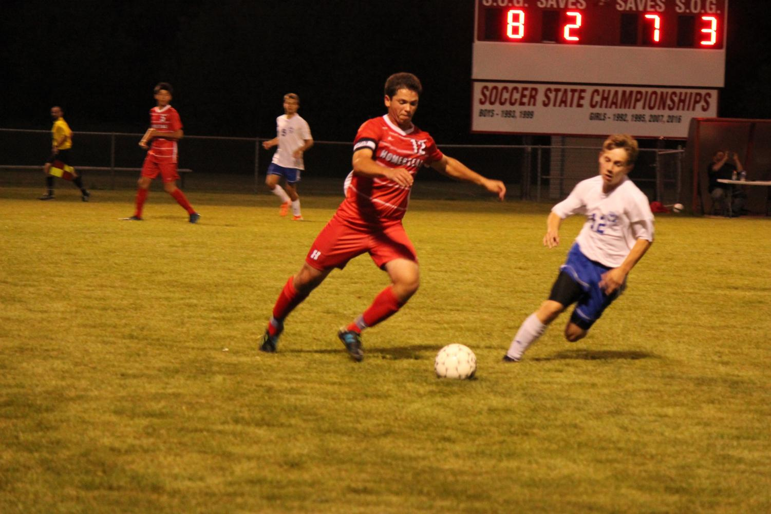 Josh Teplin, senior, dribbles the ball past his opponent during a game earlier in the season.