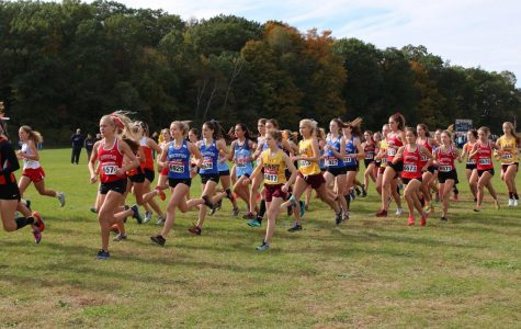 The girls varsity team begins their race on the West Bend course.