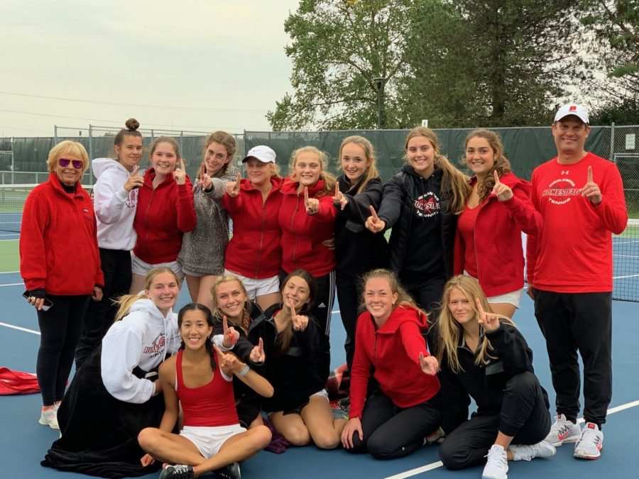 The+girls+and+coaches+pose+for+a+picture+after+winning+sectionals+at+Heyer+Park.