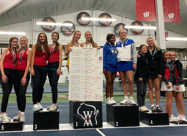 Doubles players stand on the podiums at state.
