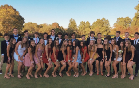 Freshmen gather at dinner before coming to their first Homecoming dance.