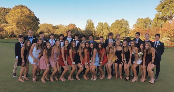 Freshmen+gather+at+dinner+before+coming+to+their+first+Homecoming+dance.+