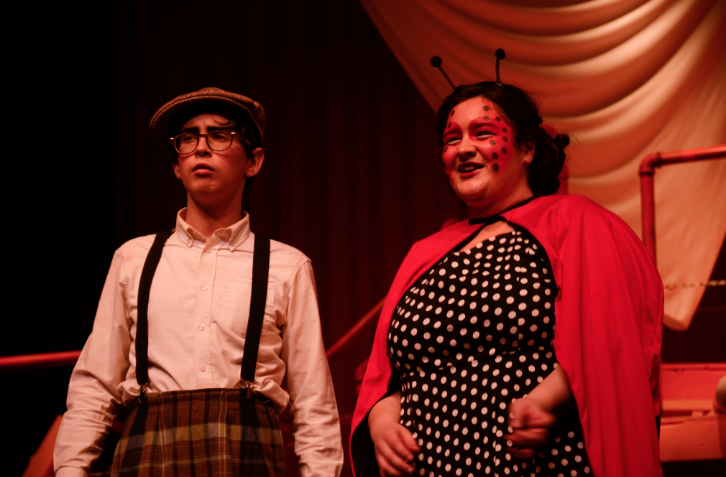 Ethan Schlesinger, senior, and Lelia Mohsenian, junior, perform as James and Mrs. Ladybug this past weekend in Homestead's production of James and the Giant Peach.