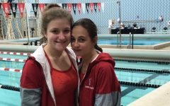 Hannah Tracy and Lauren Van Vooren dive at the WIAA state meet.