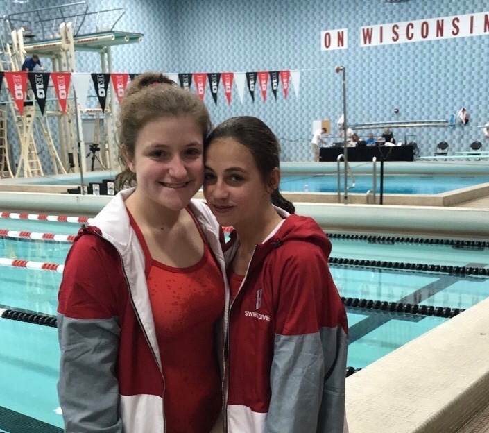 Hannah+Tracy+and+Lauren+Van+Vooren+dive+at+the+WIAA+state+meet.