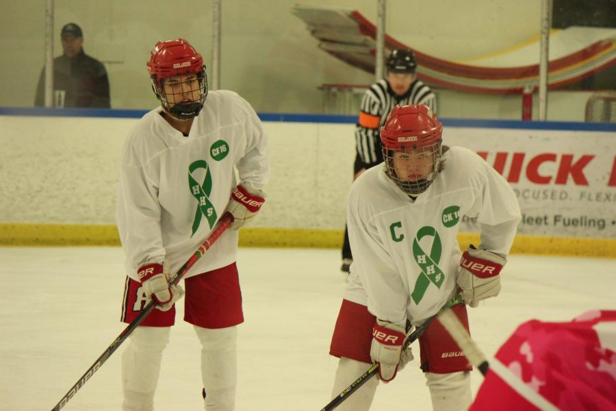 Noah+Haswell%2C+senior%2C+and+JJ+Pererz%2C+sophomore%2C+prepare+for+the+puck+drop.