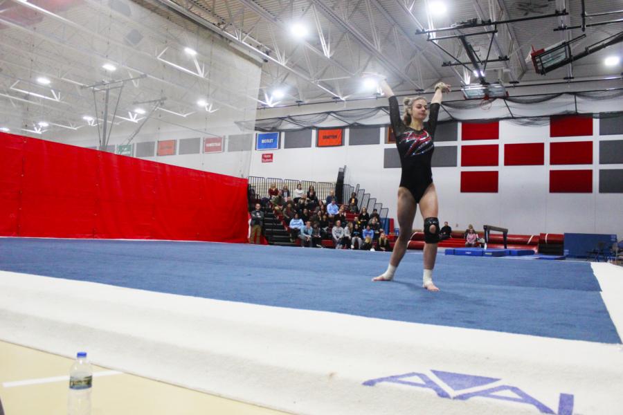 Taylor+Raskin%2C+senior%2C+performs+floor+routine.